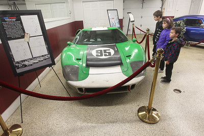"Candace H. Johnson-For Shaw Media Danny Olsen, 8, of Barrington and his siblings, Grayson, 7, and Oliver, 4, check out the Ford GT40 racing car on display in the ""Ford v Ferrari"" GT40 Special Exhibit at the Volo Auto Museum. The Holman and Moody green and white No. 95 car was one of twelve GT40 replicas built for the movie, ""Ford v Ferrari.""  The museum, which has several TV and movie cars on display, is open seven days a week 10:00 am-5:00 pm. (1/5/20)"