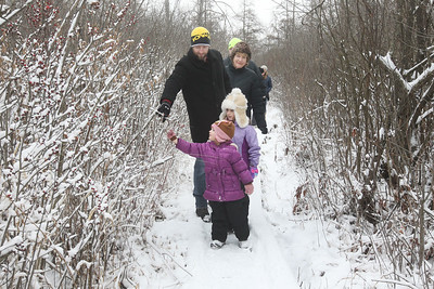 Candace H. Johnson-For Shaw Media Travis Mumm, of Volo, his daughters Nora, 3, and Teegan, 6, and parents, Debbie and Dennis Mumm, of Grayslake stop to look at a shrub called, Winterberry Holly, as they take a Bog Tour during WinterFest at the Volo Bog State Natural Area in Ingleside. (1/12/20)