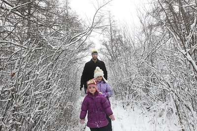 Candace H. Johnson-For Shaw Media Travis Mumm, of Volo takes a Bog Tour with his daughters Nora, 3, and Teegan, 6, during WinterFest at the Volo Bog State Natural Area in Ingleside. (1/12/20)