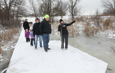 Candace H. Johnson-For Shaw Media Master Naturalist Julia Denne, of Arlington Heights (on right) gives a Bog Tour to the Mumm family during WinterFest at the Volo Bog State Natural Area in Ingleside. The boardwalk they are standing on is made of recycled milk cartons. (1/12/20)