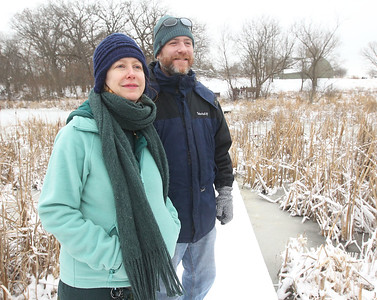 Candace H. Johnson-For Shaw Media Deb Chabi and Dan Bart, both of East Dundee, look around as they stop on the boardwalk of the Volo Bog Interpretive Trail during WinterFest at the Volo Bog State Natural Area in Ingleside. (1/12/20)