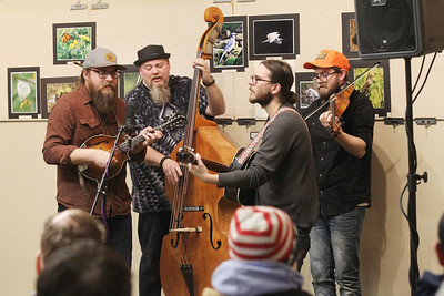 Candace H. Johnson-For Shaw Media Mark Messer, Jesse Beilfuss, Mark Swanson and Dan Pearson with the progressive Bluegrass band called, River Valley Rangers, play their music at the Visitor Center during WinterFest at the Volo Bog State Natural Area in Ingleside. (1/12/20)