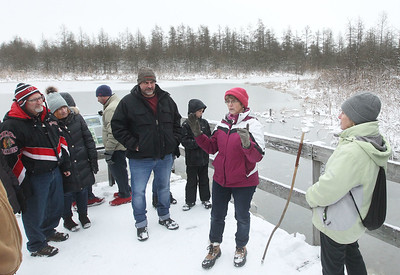 Candace H. Johnson-For Shaw Media Mary Colwell, of Libertyville, (on the right) a volunteer naturalist, stops to talk about the Eye of the Volo Bog as she gives a Bog Tour during WinterFest at the Volo Bog State Natural Area in Ingleside. (1/12/20)