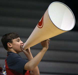 Candace H. Johnson-For Shaw Media Grant's Nate Brockman, 14, uses a megaphone with the varsity cheerleaders as they cheer on the boys varsity basketball team while they play McHenry at Grant Community High School in Fox Lake.  (1/21/20)