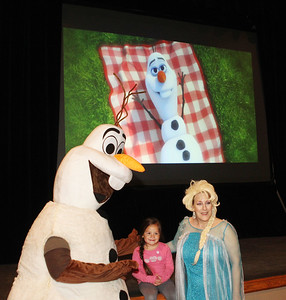 "Candace H. Johnson-For Shaw Media Emily Guzman, 4, of Grayslake gets her photo taken with Olaf and Elsa while the movie, ""Frozen,"" plays in the background during Family Fun Friday: Cookie Decorating with Elsa & Olaf at the Round Lake Beach Cultural & Civic Center. The next Family Fun Friday: Creventine Puppet Company's, ""Hands & Strings: A Puppet Variety Show,"" on Friday, Feb. 21st at 1:00 pm. (1/20/20)"