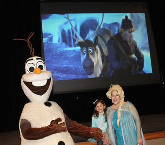 "Candace H. Johnson-For Shaw Media Grace Gilley, 6, of Crystal Lake gets her photo taken with Olaf and Elsa while the movie, ""Frozen,"" plays in the background during Family Fun Friday: Cookie Decorating with Elsa & Olaf at the Round Lake Beach Cultural & Civic Center. The next Family Fun Friday: Creventine Puppet Company's, ""Hands & Strings: A Puppet Variety Show,"" will take place on Friday, Feb. 21st at 1:00 pm. (1/20/20)"
