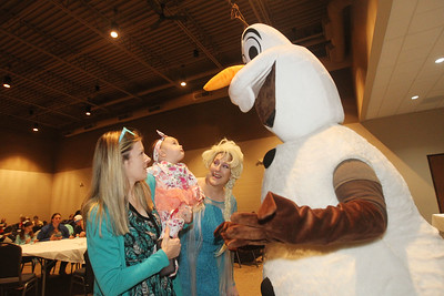 Candace H. Johnson-For Shaw Media Brooke Urbanik, of Trevor, Wis., holds her daughter, Ella, nine-months-old, as they visit with Elsa and Olaf during Family Fun Friday: Cookie Decorating with Elsa & Olaf at the Round Lake Beach Cultural & Civic Center. Ella's brother, Eli, 4, was also at the event. (1/20/20)
