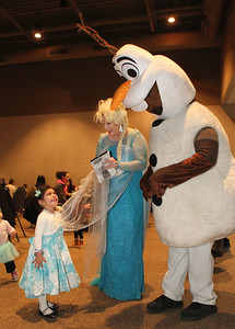 "Candace H. Johnson-For Shaw Media Lucia Santi, 3, of Gurnee visits with Elsa and Olaf during Family Fun Friday: Cookie Decorating with Elsa & Olaf at the Round Lake Beach Cultural & Civic Center. The next Family Fun Friday: Creventine Puppet Company's, ""Hands & Strings: A Puppet Variety Show,"" will take place on Friday, Feb. 21st at 1:00 pm. (1/20/20)"