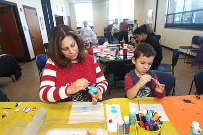 Candace H. Johnson-For Shaw Media Lucinda Smetana, of Grayslake and her son, Hayden, 4, paint kindness rocks during the Kindness Crafts – MLK Day ON, Not a Day Off event in honor of Martin Luther King Jr. Day at the Grayslake Area Public Library. (1/20/20)