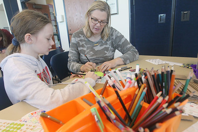 Candace H. Johnson-For Shaw Media Kiera Young, 10, of Grayslake an her mother, Kris, work on writing a thank you card for a veteran during the Kindness Crafts – MLK Day ON, Not a Day Off event in honor of Martin Luther King Jr. Day at the Grayslake Area Public Library. (1/20/20)