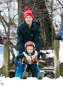 Frank Huschitt V is held ready by his father Frank Huschitt IV on the 5M start at the Norge Ski Club International Winter Ski Tournament 2020 held on Saturday, January 25, 2020 in Fox River Grove, IL. Saturday's events included junior competitions. The K70 event was canceled due deteriorating weather conditions.
