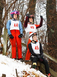 L-R: Abby Ashcraft (44), Beth Frolik (46), and Liesel Bakk-Hansen (45) cheer on their friends at the Norge Ski Club International Winter Ski Tournament 2020 held on Saturday, January 25, 2020 in Fox River Grove, IL. Saturday's events included junior competitions. The K70 event was canceled due deteriorating weather conditions.