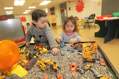 Candace H. Johnson-For Shaw Media Keiji Dinquel, 2, of Grayslake and Lily Sedivy, 3, of Chicago play at the excavation table during the Chinese New Year Celebration at the Busy Brains Children's Museum pop-up location at the Grayslake Heritage Center & Museum. The next special day, Ground Hog Day Celebration, will be on Sunday, February 2nd, from 9-2:00 pm. The Busy Brains Children's Museum pop-up location will be at the Grayslake Heritage Center & Museum until March 14th. The pop-up location is open every day from 9-2:00 pm. except for Tuesday, 9-8:00pm and Friday, they are closed. (1/25/20)