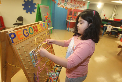 Candace H. Johnson-For Shaw Media Annabella Diaz, 8, of Round Lake plays with a Pegometry board during the Chinese New Year Celebration at the Busy Brains Children's Museum pop-up location at the Grayslake Heritage Center & Museum. Annabella was at the museum with her father, Michael. (1/25/20)