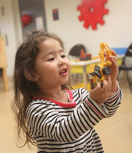 Candace H. Johnson-For Shaw Media Lily Sedivy, 3, of Chicago plays with an excavator toy during the Chinese New Year Celebration at the Busy Brains Children's Museum pop-up location at the Grayslake Heritage Center & Museum. Lily was at the museum with her father, Joe. (1/25/20)