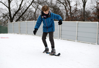 Owen Trimble, 9, of Deer Park, Ill., slides down a hill during the 116th Norge Annual Winter Ski Jump Tournament at the Norge Ski Club in Fox River Grove, Ill., on Saturday, Jan. 30, 2021.