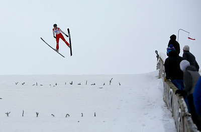 Carter Lee competes in the U20 Male Division of the 116th Norge Annual Winter Ski Jump Tournament at the Norge Ski Club in Fox River Grove, Ill., on Saturday, Jan. 30, 2021.