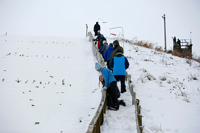 Attendees watch skiers compete during the 116th Norge Annual Winter Ski Jump Tournament at the Norge Ski Club in Fox River Grove, Ill., on Saturday, Jan. 30, 2021.