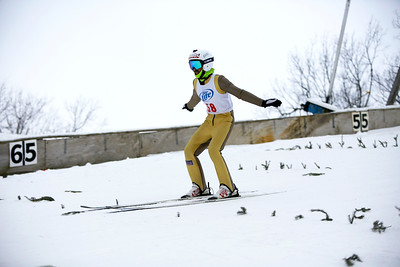 Tony Benzie competes in the Masters Division of the 116th Norge Annual Winter Ski Jump Tournament at the Norge Ski Club in Fox River Grove, Ill., on Saturday, Jan. 30, 2021.