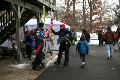 People attend the 116th Norge Annual Winter Ski Jump Tournament at the Norge Ski Club in Fox River Grove, Ill., on Saturday, Jan. 30, 2021.