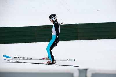 A skier competes in the 116th Norge Annual Winter Ski Jump Tournament at the Norge Ski Club in Fox River Grove, Ill., on Saturday, Jan. 30, 2021.