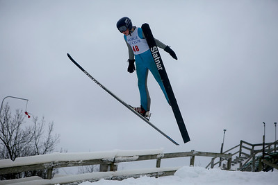 Liam Nichols jumps while competing in the 116th Norge Annual Winter Ski Jump Tournament at the Norge Ski Club in Fox River Grove, Ill., on Sunday, Jan. 31, 2021.