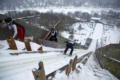 Skiers compete in the 116th Norge Annual Winter Ski Jump Tournament at the Norge Ski Club in Fox River Grove, Ill., on Sunday, Jan. 31, 2021.