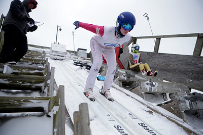 Logan Gundry jumps while competing in the 116th Norge Annual Winter Ski Jump Tournament at the Norge Ski Club in Fox River Grove, Ill., on Sunday, Jan. 31, 2021.