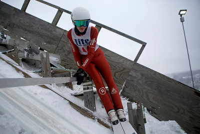 Stewart Gundry prepares to jump while competing in the 116th Norge Annual Winter Ski Jump Tournament at the Norge Ski Club in Fox River Grove, Ill., on Sunday, Jan. 31, 2021.