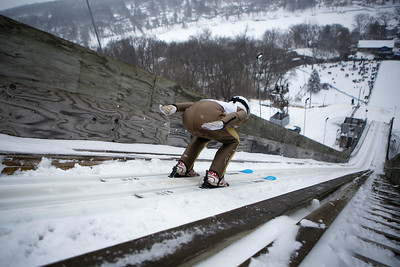 A skier jumps while competing in the 116th Norge Annual Winter Ski Jump Tournament at the Norge Ski Club in Fox River Grove, Ill., on Sunday, Jan. 31, 2021.