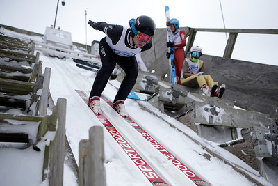 Lucas Nichols jumps while competing in the 116th Norge Annual Winter Ski Jump Tournament at the Norge Ski Club in Fox River Grove, Ill., on Sunday, Jan. 31, 2021.