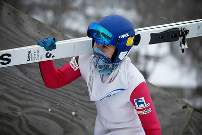 Logan Gundry walks up the steps while competing in the 116th Norge Annual Winter Ski Jump Tournament at the Norge Ski Club in Fox River Grove, Ill., on Sunday, Jan. 31, 2021.