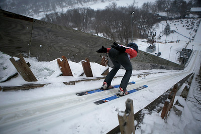Isak Nichols jumps while competing in the 116th Norge Annual Winter Ski Jump Tournament at the Norge Ski Club in Fox River Grove, Ill., on Sunday, Jan. 31, 2021.