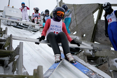 Isak Nichols prepares to jump while competing in the 116th Norge Annual Winter Ski Jump Tournament at the Norge Ski Club in Fox River Grove, Ill., on Sunday, Jan. 31, 2021.