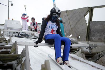 Nathan Krotz prepares to jump while competing in the 116th Norge Annual Winter Ski Jump Tournament at the Norge Ski Club in Fox River Grove, Ill., on Sunday, Jan. 31, 2021.