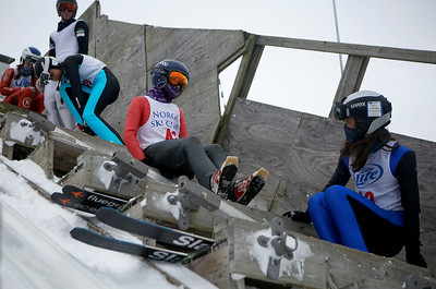 Skiers wait to jump while competing in the 116th Norge Annual Winter Ski Jump Tournament at the Norge Ski Club in Fox River Grove, Ill., on Sunday, Jan. 31, 2021.