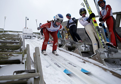 Sophia Schreiner jumps while competing in the 116th Norge Annual Winter Ski Jump Tournament at the Norge Ski Club in Fox River Grove, Ill., on Sunday, Jan. 31, 2021.