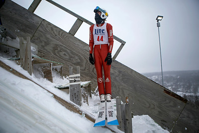 Stewart Gundry waits on the steps before his jump while competing in the 116th Norge Annual Winter Ski Jump Tournament at the Norge Ski Club in Fox River Grove, Ill., on Sunday, Jan. 31, 2021.