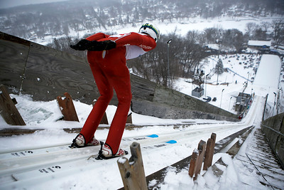Stewart Gundry jumps while competing in the 116th Norge Annual Winter Ski Jump Tournament at the Norge Ski Club in Fox River Grove, Ill., on Sunday, Jan. 31, 2021.
