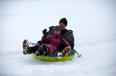 Mark Jensen and Dayce Jensen, 12, of Barrington, Ill., sled at Picnic Grove Park, in Fox River Grove, Ill., on Sunday, Jan. 31, 2021.