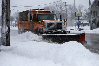 A snowplow clears snow from Route 14 in Barrington, Ill., on Sunday, Jan. 31, 2021.