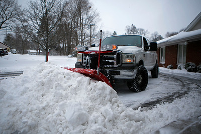 The Cary-Grove Area Chamber of Commerce parking lot is cleared of snow in Cary, Ill., on Sunday, Jan. 31, 2021.