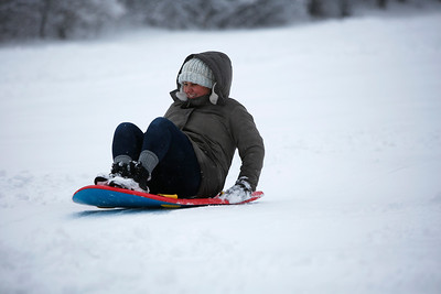Taylor Jordan, of Chicago, sleds at Picnic Grove Park, in Fox River Grove, Ill., on Sunday, Jan. 31, 2021.