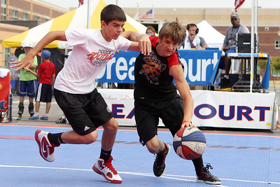Mike Greene - mgreene@shawmedia.com Midwest All-Star's Derek Kyler (left), 13 of DeKalb defends Street King's Creighton Nice, of Marengo, during the 2nd annual Gus Macker 3-on-3 Basketball Tournament at Marengo Community High School Sunday, July 1, 2012 in Marengo.