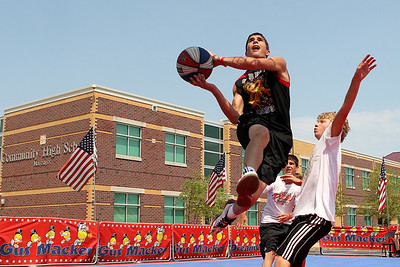 Mike Greene - mgreene@shawmedia.com Street King's Zack Knoblach, of Marengo, goes in for a layup against the Midwest All-Stars during the 2nd annual Gus Macker 3-on-3 Basketball Tournament at Marengo Community High School Sunday, July 1, 2012 in Marengo.