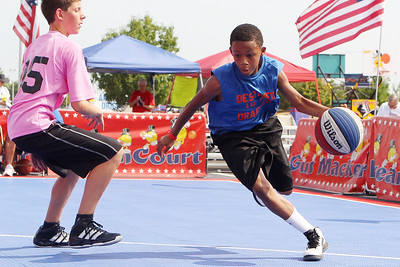 Mike Greene - mgreene@shawmedia.com Destined to be Drafted's Maurice Commander, 12 of Chicago, drives towards the hoop while playing against We Love Chuck during the 2nd annual Gus Macker 3-on-3 Basketball Tournament at Marengo Community High School Sunday, July 1, 2012 in Marengo.