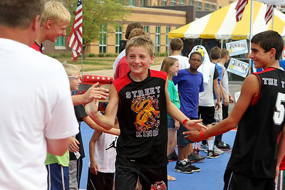 Mike Greene - mgreene@shawmedia.com Street King's Ben Volkening, of Marengo, high-fives teammates before playing against the Midwest All-Stars during the 2nd annual Gus Macker 3-on-3 Basketball Tournament at Marengo Community High School Sunday, July 1, 2012 in Marengo.