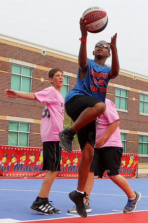 Mike Greene - mgreene@shawmedia.com Destined to be Drafted's Leroy Patterson Jr., 12 of Chicago, goes in for a layup while playing against We Love Chuck during the 2nd annual Gus Macker 3-on-3 Basketball Tournament at Marengo Community High School Sunday, July 1, 2012 in Marengo.