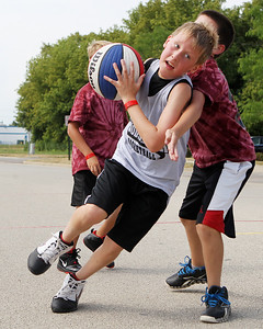 Mike Greene - mgreene@shawmedia.com Fast Break's Ethan Ritter, 10 of Woodstock, drives while playing against Cagers during the 2nd annual Gus Macker 3-on-3 Basketball Tournament at Marengo Community High School Sunday, July 1, 2012 in Marengo.