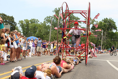 Mike Greene - mgreene@shawmedia.com Members of the crowd take part in a stunt with Wacky Wheelers/Jolly Giants during the Annual Independence Day Parade Sunday, July 1, 2012 in Crystal Lake. Over 100 different groups participated in the parade from City Hall to the Lakeside Festival.